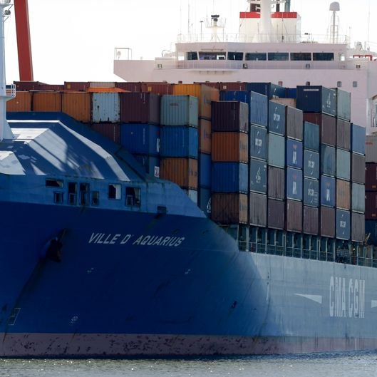 A ship named Ville D' Aquarius is docked at the Port Newark container terminal, Wednesday, June 27, 2012, in Newark, N.J. The Coast Guard suspects there are stowaways in a container that was loaded on a ship. Coast Guard spokesman Charles Rowe says the container was loaded aboard The Villa D'Aquarius in India. The manifest says the container was carrying machine parts to be unloaded in Norfolk, Va. (AP Photo/Julio Cortez)