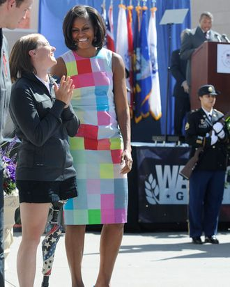First lady Michelle†Obama, left, is escorted by Tech Sgt. Jordan Bishopp upon her arrival at Kirtland Air Force Base, in Albuquerque, N.M., on Tuesday, May 1, 2012. The visit was the last in a two-day, four-state campaign and fundraising swing through the region. (AP Photo/J.R. Oppenheim)