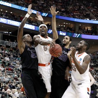 PITTSBURGH, PA - MARCH 17: C.J. Fair #5 of the Syracuse Orange drives for a shot attempt in the first half against Jordan Henriquez #21 and Adrian Diaz #20 of the Kansas State Wildcats during the third round of the 2012 NCAA Men's Basketball Tournament at Consol Energy Center on March 17, 2012 in Pittsburgh, Pennsylvania. (Photo by Jared Wickerham/Getty Images)