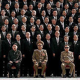 In this detail from a photo released by Korean Central News Agency via Korean News Service on September 30, 2010 North Korean leader Kim Jong-Il (R, front row) and the man believed to be his son Kim Jong-un, (L, front row).