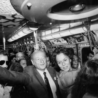 Mayor Ed Koch and Senatorial candidate Bess Myerson campaigning on the subway. September 1980.