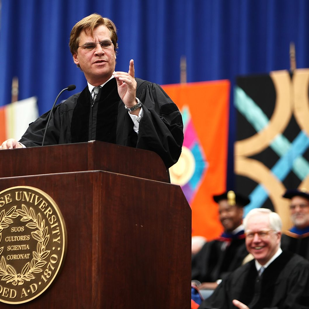 Aaron Sorkin, screenwriter, producer and playwright, points as he looks to the crowd during an address