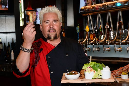 LAS VEGAS, NV - APRIL 04:  Chef and television personality Guy Fieri talks about his menu items during a welcome event for Guy Fieri's Vegas Kitchen & Bar at The Quad Resort & Casino on April 4, 2014 in Las Vegas, Nevada. The restaurant opens on April 17.  (Photo by Ethan Miller/Getty Images for Caesars Entertainment)