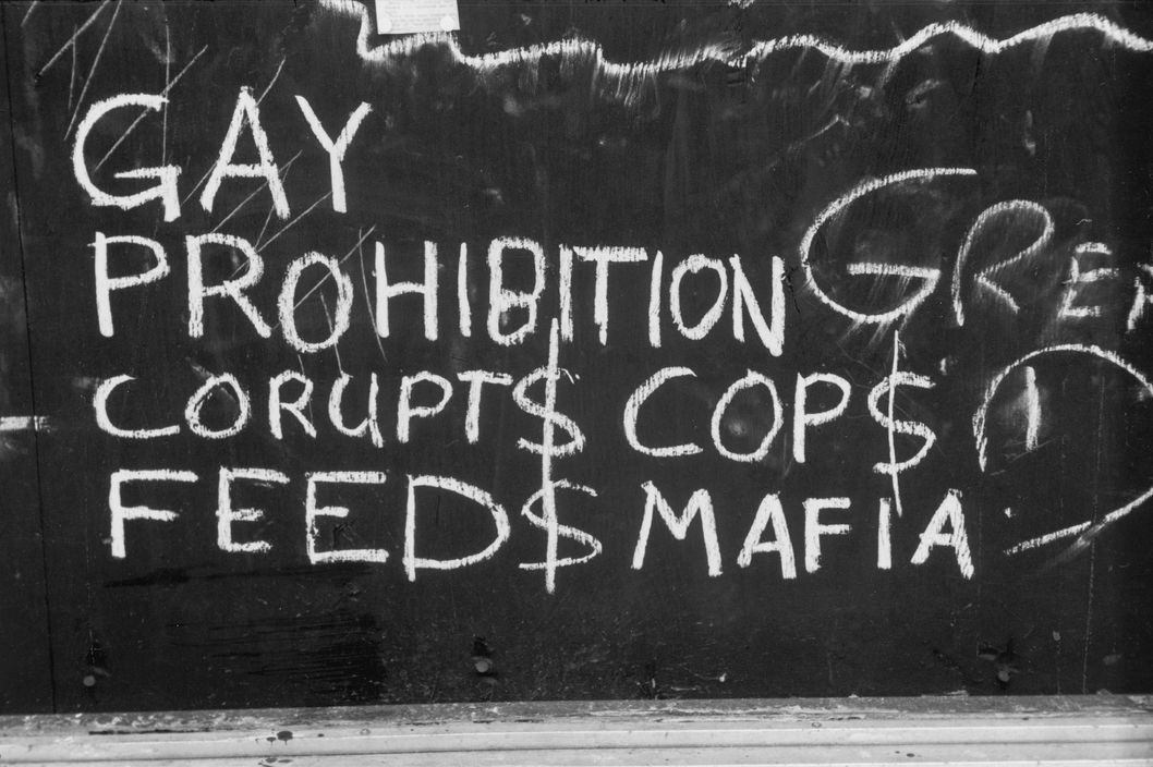 Close-up of handwritten chalk text on a boarded-up window of the Stonewall Inn (53 Christopher Street) after riots over the weekend of June 27, 1969. The text reads 'Gay Prohibition Corupts (sic) Cops and Feeds Mafia' and refers to payoffs made to police officers by the owners of gang-operated, then-illegal gay bars. The bar and surrounding area were the site of a series of demonstrations and riots over the weekend that led to the formation of the modern gay rights movement in the United States. (Photo by Fred W. McDarrah/Getty Images)