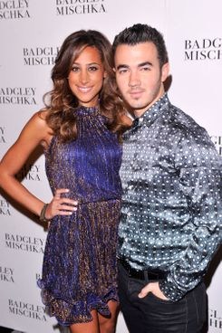 NEW YORK, NY - SEPTEMBER 11:  Danielle Deleasa and Kevin Jonas pose backstage at the Badgley Mischka show during the Spring 2013 Mercedes-Benz Fashion Week at The Theatre at Lincoln Center on September 11, 2012 in New York City.  (Photo by Stephen Lovekin/Getty Images for Mercedes-Benz Fashion Week)