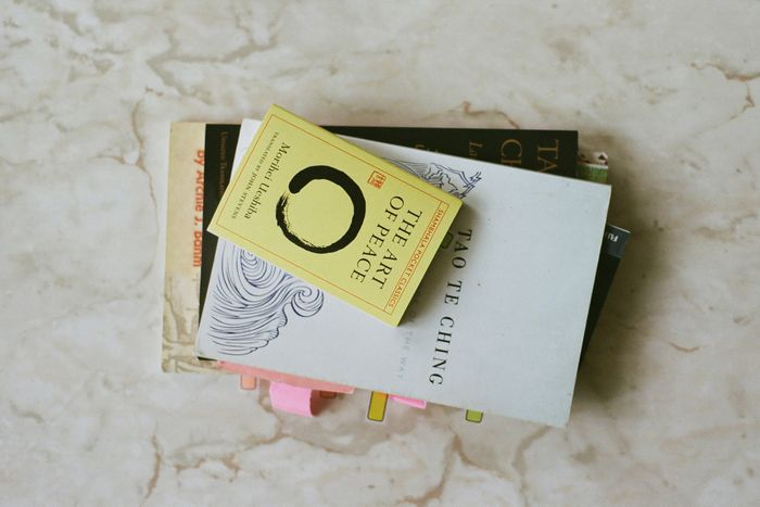 A stack of books on a marble table