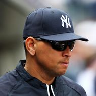 Alex Rodriguez #13 of the New York Yankees looks on from the dugout during the game against the Boston Red Sox on Opening Day on April 1, 2013 at Yankee Stadium in the Bronx borough of New York City.