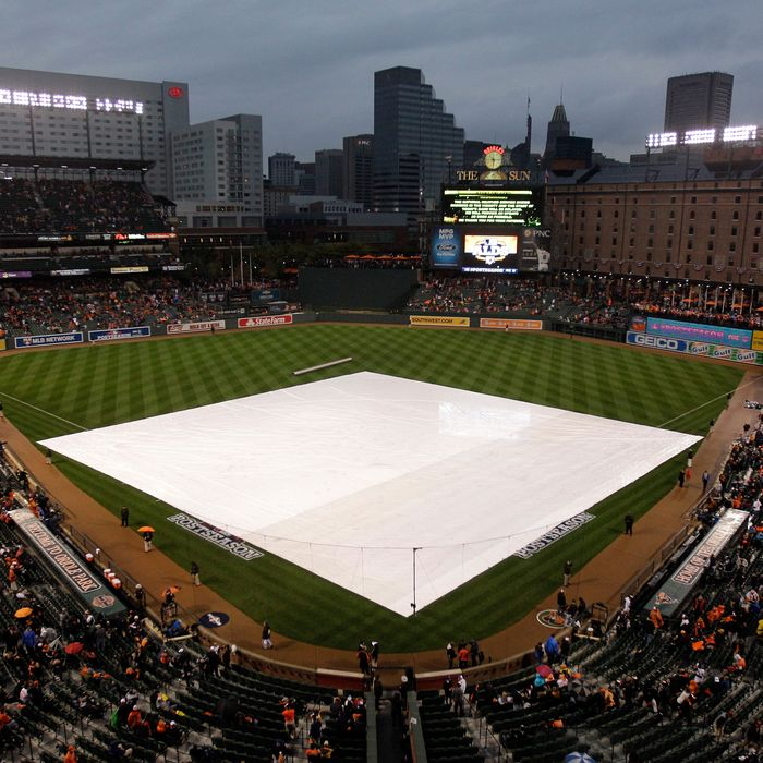 The tarp is seen on the field prior to the Baltimore Orioles hosting the New York Yankees during Game One of the American League Division Series at Oriole Park at Camden Yards on October 7, 2012 in Baltimore, Maryland.