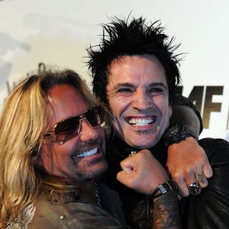 WEST HOLLYWOOD, CA - AUGUST 18: Motley Crue band members (L-R) Vince Neil and Tommy Lee arrive at the Annual Sunset Strip Music Festival, Tribute to Motley Crue at the House of Blues Sunset Blvd on August 18, 2011 in West Hollywood, California. (Photo by Frazer Harrison/Getty Images)