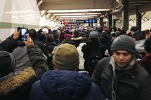NEW YORK, NY - FEBRUARY 05: (EDITORS NOTE: Image was created with a smartphone.) Commuters walk through the MTA Subway at 42nd St/Times Square after there were delays with some of the trains due to inclement weather on February 5, 2014 in New York City. The Northeast was hit with yet another snow storm today, bringing snow and ice over night, and sleet and freezing rain during the day. (Photo by Amy Robertson/Getty Images)