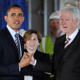 WASHINGTON, DC - DECEMBER 2: (AFP OUT) U.S. President Barack Obama (L) and former President Bill Clinton tour a