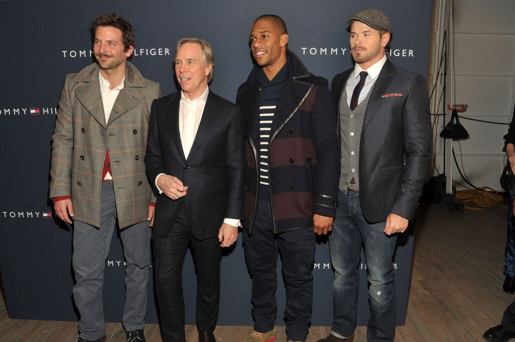 NEW YORK, NY - FEBRUARY 10:  (L-R) Bradley Cooper, designer Tommy Hilfiger, New York Giants wide receiver Victor Cruz, and Kellan Lutz pose backstage at the Tommy Hilfiger Men's Fall 2012 fashion show during Mercedes-Benz Fashion Week on February 10, 2012 in New York City.  (Photo by Joe Corrigan/Getty Images for Mercedes-Benz Fashion Week)