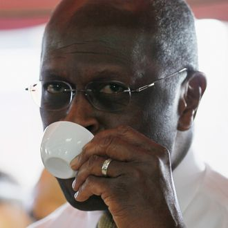 MIAMI, FL - NOVEMBER 16: Republican Presidential candidate Herman Cain drinks a Cuban coffee during a campaign visit to Versailles, a Cuban restaurant, in the Little Havana neighborhood on November 16, 2011 in Miami, Florida. Cain was in South Florida on a campaign swing. (Photo by Joe Raedle/Getty Images)