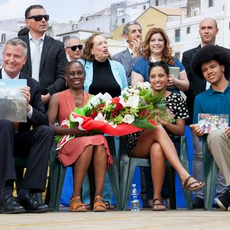 MATERA, ITALY - JULY 24: New York City Mayor Bill de Blasio, Chirlane McCray, Chiara de Blasio and Dante de Blasio receive gifts during a visit to Mayor de Blasio's grandmother's town on July 24, 2014 in Matera, Italy. The New York City mayor and his family are on an eight-day holiday in Italy but de Blasio has plans to meet with Italy's foreign minister, Federica Mogherini, and with Pietro Parolin, the Holy Sees secretary of state. (Photo by Giovanni Marino/Getty Images)