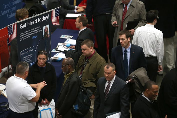 People visit booths of prospective employers during the Hiring Our Heroes job fair at the Washington Convention Center, on January 10, 2014 in Washington, DC.
