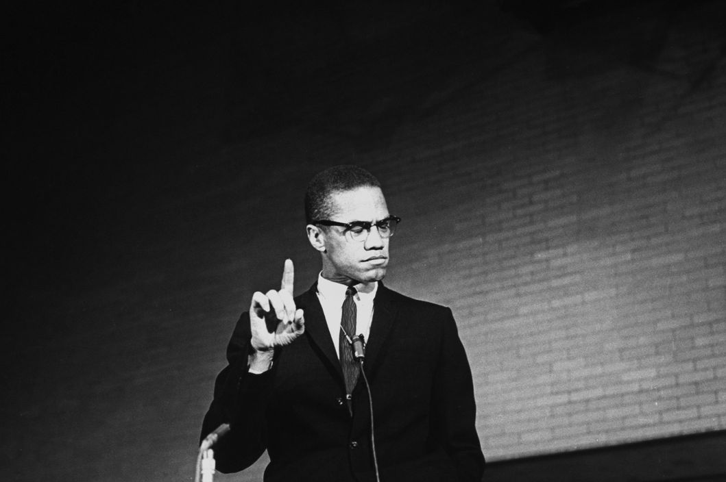 Black Nationalist ldr. Malcolm X pointing finger upward during speech at rally as other unidents. look on.  (Photo by Time Life Pictures/Pix Inc./Time Life Pictures/Getty Images)