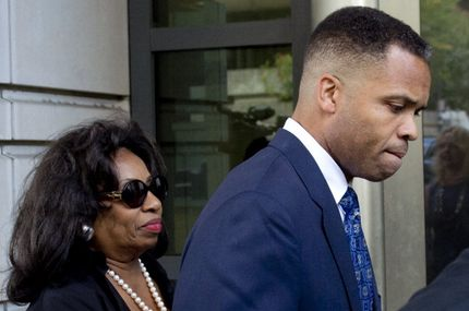 Former Illinois Congressman Jesse Jackson Jr., walks with his mother, Jacqueline lavinia Brown, as he leaves the US District Court in Washington, DC, August 14, 2013, following a sentencing hearing. Jackson was sentenced today to 30 months behind bars and his wife, Sandi, got a year in prison for separate felonies involving the misspending of about $750,000 in campaign funds. The Jacksons will be allowed to serve their sentences one at a time, with Jackson Jr. going first. In addition to the 2.5 years in prison, Jackson Jr. was sentenced to three years of supervised release. Sandi Jackson was ordered to serve 12 months of supervised release following her prison term.