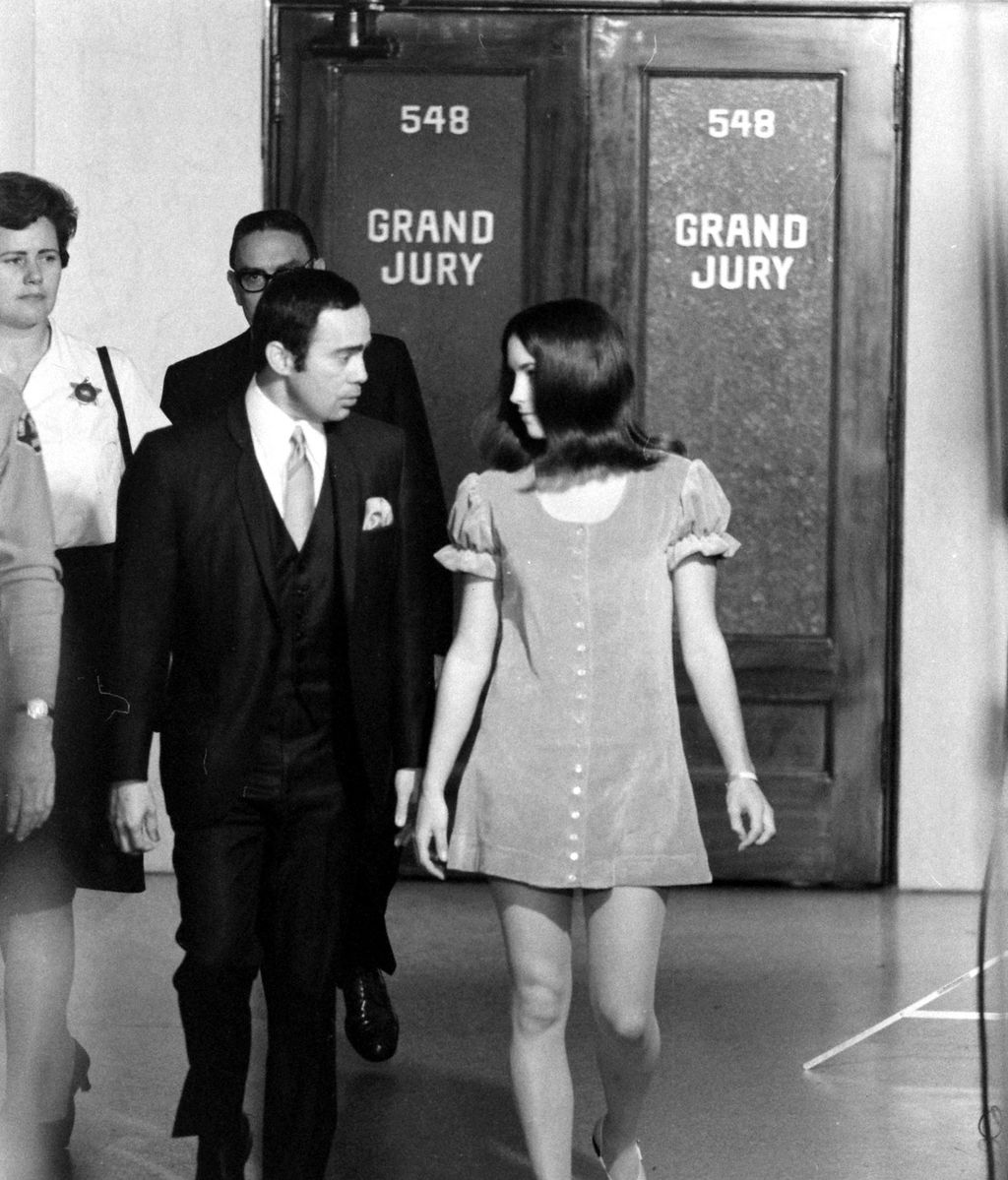 Susan Adkins, who was eventually convicted of the Manson family murders, leaves the grand jury room in a babydoll dress.