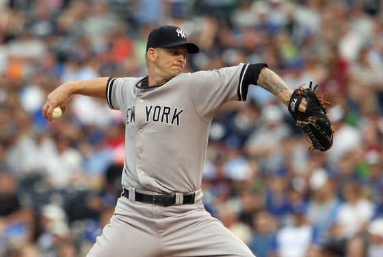 KANSAS CITY, MO - AUGUST 15:  Starting pitcher A.J. Burnett #34 of the New York Yankees pitches during the game against the Kansas City Royals at Kauffman Stadium on August 15, 2011 in Kansas City, Missouri.  (Photo by Jamie Squire/Getty Images)