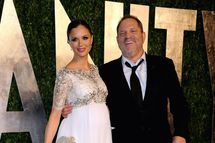 Designer Georgina Chapman (L) and Harvey Weinstein, co-chairman of The Weinstein Company arrive at the 2013 Vanity Fair Oscar Party hosted by Graydon Carter at Sunset Tower on February 24, 2013 in West Hollywood, California.