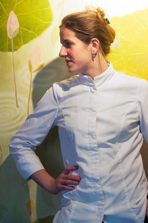 "French chef Adeline Grattard in her Franco-Cantonese restaurant ""Yam'Tcha"" in Paris. The 32-year-old French chef who serves tea to match her Chinese-themed dishes won a precious star in the latest edition of France's prestigious Michelin restaurant guide."