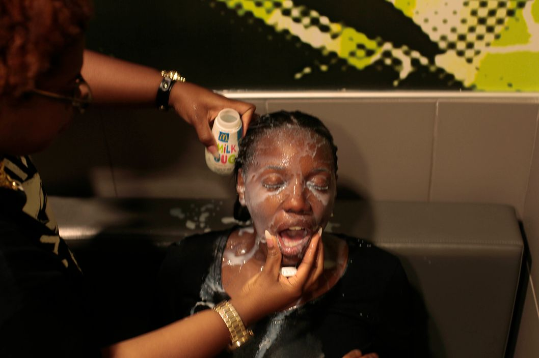 FERGUSON, MO - AUGUST 17:  A woman has her face doused with milk after suffering the effects of tear gas used by police at a protest of the death of Michael Brown August 17, 2014 in Ferguson, Missouri. Tensions still run high in the Ferguson community after 18 -year-old Michael Brown was killed by a Ferguson police officer August 9 on Canfield Drive.  (Photo by Joshua Lott/Getty Images)