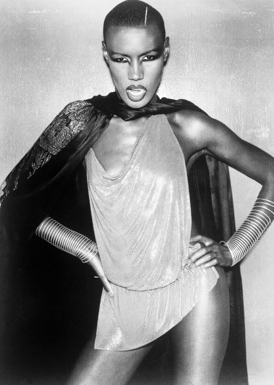 "Grace Jones continually tries to defy gendered and sexual norms, especially with her hairstyle. She sported a traditionally male <a href=""http://www.google.com/imgres?imgurl=http://images.tribe.net/tribe/upload/photo/407/ef8/407ef8c0-ea7c-4294-9026-02858cc663e7&imgrefurl=http://tribes.tribe.net/androgynyishot/photos/407ef8c0-ea7c-4294-9026-02858cc663e7&h=500&w=357&sz=35&tbnid=wRpNWhBPsp8vkM:&tbnh=111&tbnw=79&zoom=1&usg=__3mKqOt4Y0X9XfTFKXXbHsCxVVf8=&docid=xzIZZCOdGybn7M&sa=X&ei=uZkRUZiwNMXv0QGYtIH4AQ&ved=0CDUQ9QEwAA&dur=197"">flat top</a> in the James Bond movie <i>A View to Kill</i>, and routinely shaves her head. There <a href=""http://www.guardian.co.uk/music/2010/apr/17/grace-jones-interview"">was once a rumor</a> she lived on cocaine and oysters. When the <i>Guardian </i><a href=""http://www.guardian.co.uk/music/2010/apr/17/grace-jones-interview"">reported in 2010</a> that Jones had switched to red wine and oysters, Grace rebutted, ""You don't do oysters and red wine together. That's a no-no, you just don't do that. I love a nice white wine with oysters."""