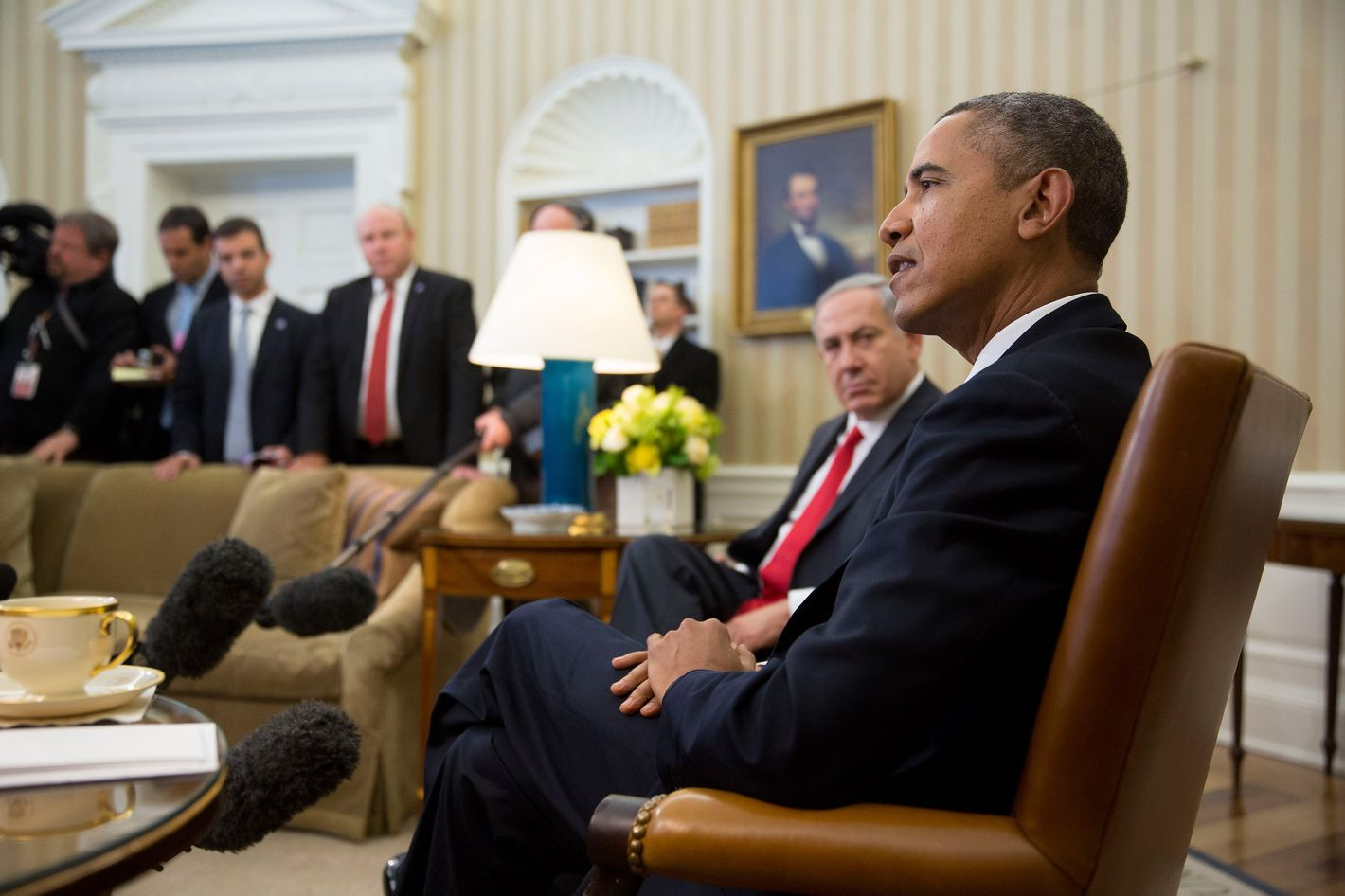 """Israel Prime Minister Benjamin Netanyahu (L) sits with U.S. President Barack Obama during a meeting in the Oval Office of the White House March 3, 2014 in Washington, D.C. Obama urged Netanyahu to """"seize the moment"""" to make peace, saying time is running out of time to negotiate an Israeli-Palestinian agreement."""
