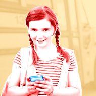 Portrait of schoolgirl holding smart phone.