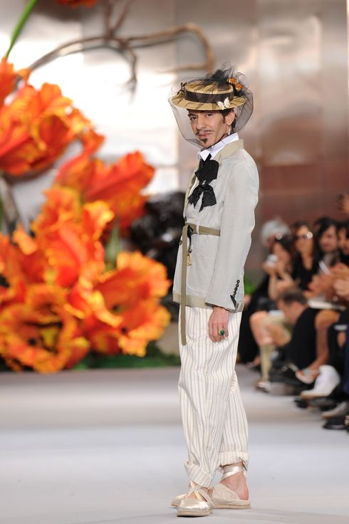 Designer John Galliano walks the runway at the end of the Dior show as part of the Paris Haute Couture Fashion Week Fall/Winter 2011 at Musee Rodin on July 5, 2010 in Paris, France.