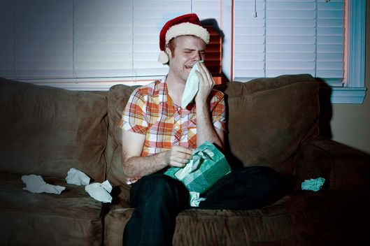 Young man watching tv, crying --- Image by ? Image Source/Corbis