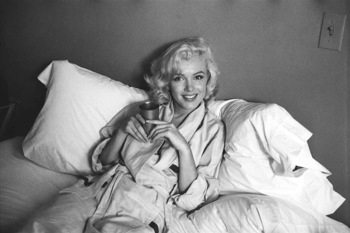 Look marilyn monroe in bed and sticking her tongue out in marilyn