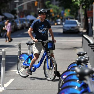 A man returns his Citi Bike bicycle to a station near Union Square as the bike sharing system is launched May 27, 2013 in New York. About 330 stations in Manhattan and Brooklyn will have thousands of bicycles for rent.