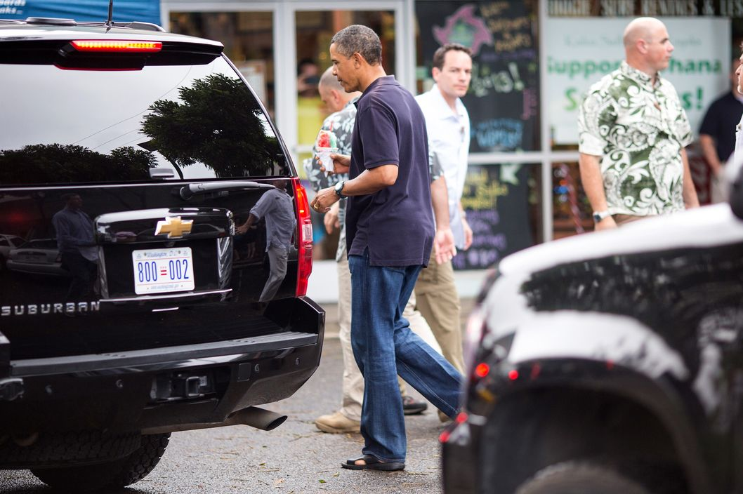 KAILUA,  HAWAII - JANUARY 3:  U.S. President Barack Obama walks to his motorcade after greeting well wishers outside of Island Snow on January 3, 2013 in Kailua, Hawaii. The president, having cut short his holiday vacation to work in Washington on efforts to avert the recent fiscal cliff crisis, returned to Hawaii on Wednesday to be with the first lady and and his daughters.  (Photo by Kent Nishimura-Pool/Getty Images)