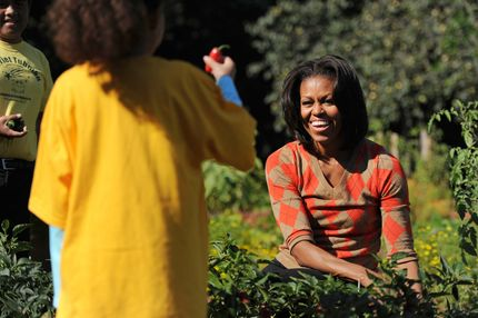 WASHINGTON, DC - OCTOBER 5: U.S. first lady Michelle Obama harvests vegetables with local children from Bancroft and Tubman Elementary schools as they participate in the White House Kitchen Garden Fall Harvest, October 5, 2011 at the White House in Washington, DC. Michelle Obama planted the White House kitchen garden to help connect kids with the food they eat as part of her Let's Move! initiative. (Photo by Patrick Smith/Getty Images)