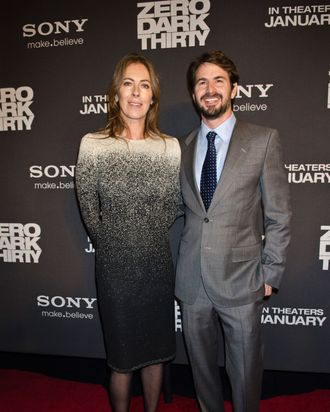 Kathryn Bigelow and Mark Boal pose for photos at the Newseum during the