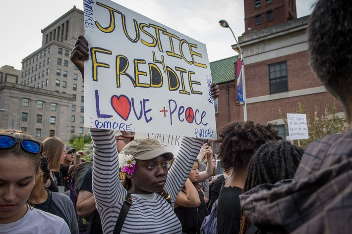 Protestors march in solidarity for Freddie Gray in downtown Baltimore, MD. April 29, 2015. Baltimore remains in unrest following the death of city resident Freddie Gray who was arrested for possessing a switch blade knife and died while in custody of the Baltimore Police.