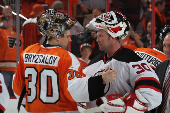 PHILADELPHIA, PA - MAY 08: Ilya Bryzgalov #30 of the Philadelphia Flyers and Martin Brodeur #30 of the New Jersey Devils shake hands following the Devils victory over the Philadelphia Flyers in Game Five of the Eastern Conference Semifinals during the 2012 NHL Stanley Cup Playoffs at Wells Fargo Center on May 8, 2012 in Philadelphia, Pennsylvania. The Devils defeated the Flyers 3-1 to win the series four games to one. (Photo by Bruce Bennett/Getty Images)