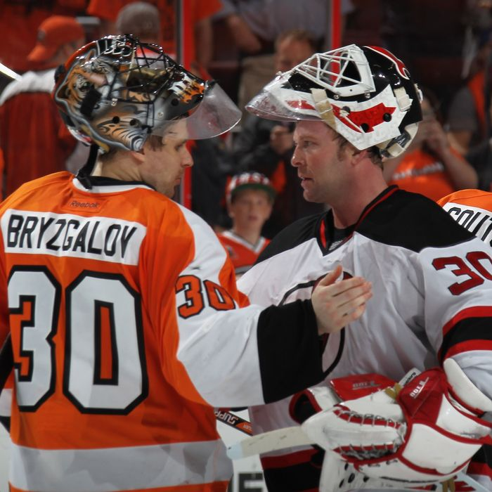 Ilya Bryzgalov #30 of the Philadelphia Flyers and Martin Brodeur #30 of the New Jersey Devils shake hands following the Devils victory over the Philadelphia Flyers in Game Five of the Eastern Conference Semifinals during the 2012 NHL Stanley Cup Playoffs at Wells Fargo Center on May 8, 2012 in Philadelphia, Pennsylvania. The Devils defeated the Flyers 3-1 to win the series four games to one.