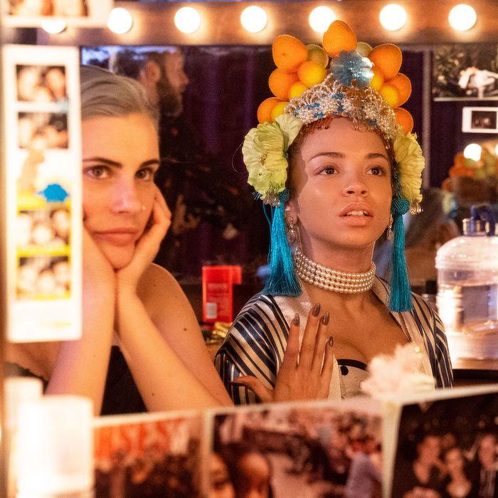 Caitlyn Ary and Erica Gluck look into a mirror