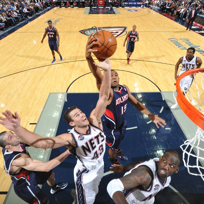 NEWARK, NJ - DECEMBER 27: Kris Humphries #43 of the New Jersey Nets has his shot blocked by Al Horford #15 of the Atlanta Hawks during the home opener on December 27, 2011 at the Prudential Center in Newark, New Jersey. NOTE TO USER: User expressly acknowledges and agrees that, by downloading and/or using this Photograph, user is consenting to the terms and conditions of the Getty Images License Agreement. Mandatory Copyright Notice: Copyright 2011 NBAE (Photo by Jesse D. Garrabrant/NBAE via Getty Images)