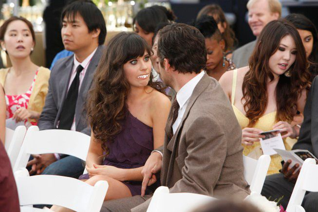 """NEW GIRL:  Jess (Zooey Deschanel, L) surprises Nick (Jake Johnson, R) when she agrees to be his date at a wedding in the """"Wedding"""" episode of NEW GIRL airing Tuesday, Oct. 4 (9:01-9:31 PM ET/PT) on FOX.  ©2011 Fox Broadcasting Co.  Cr:  Greg Gayne/FOX"""