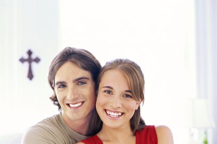Portrait of a Teenage Boy Embracing a Teenage Girl --- Image by ? Ocean/Corbis