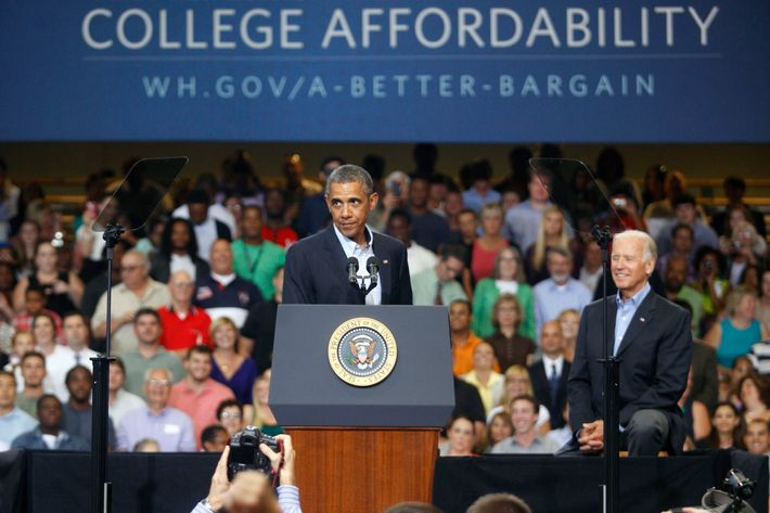 SCRANTON, PA - AUGUST 23: U.S. President Barack Obama, (L) speaks at an event as U.S. Vice President Joe Biden, (R), looks on at Lackawanna College on August 23, 2013 in Scranton, Pennsylvania. Obama is on his second day of a bus tour of New York and Pennsylvania to discuss his plan to make college more affordable, tackle rising costs, and improve value for students and their families. (Photo by Jessica Kourkounis/Getty Images)