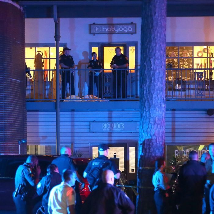 Police investigators work the scene of a shooting at Hot Yoga Tallahassee on Friday, November 2.