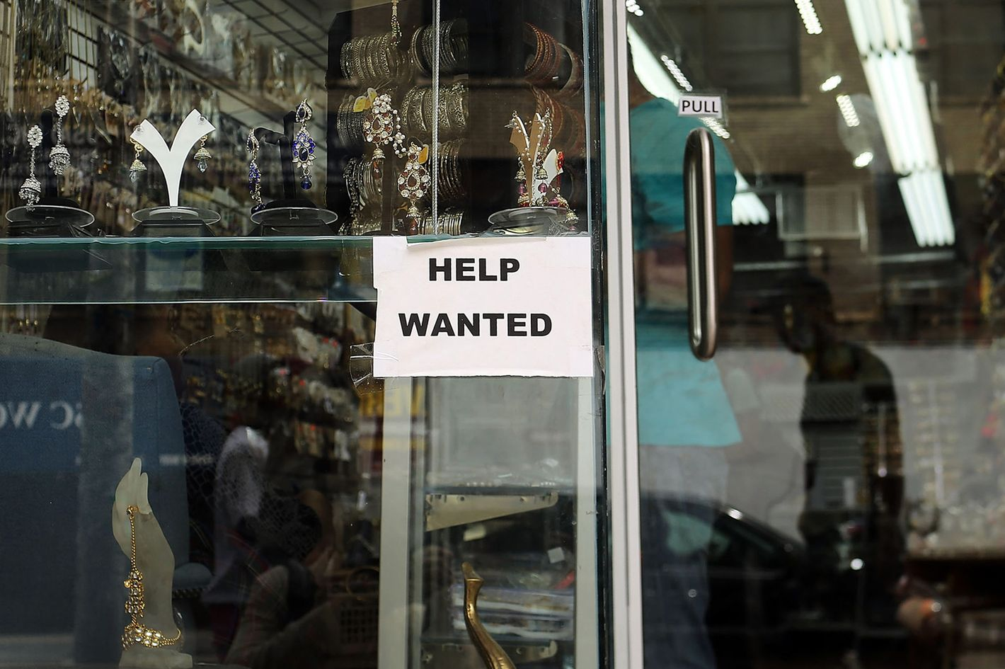 "NEW YORK, NY - AUGUST 07:  A ""help wanted"" sign is viewed in the window of a store on August 7, 2012 in New York City.  In a further sign that the American economy may be improving the U.S. labor Department said Tuesday that employers posted the most job openings in four years in June. The data comes after Friday?s news that said employers in July added the most jobs in five months.  (Photo by Spencer Platt/Getty Images)"