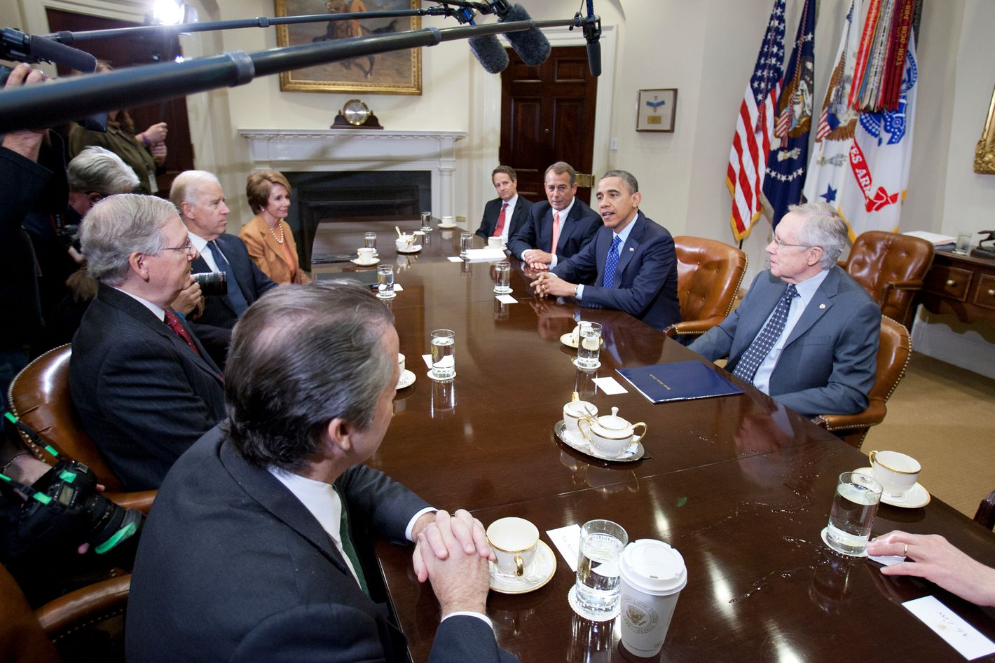 US President Barack Obama(2nd R) and Vice President Joe Biden (across) meet at the White House with Senate Majority Leader Harry Reid (D-NV), Senate Minority Leader Mitch McConnell (R-KY), Speaker John Boehner (R-OH) House Minority Leader Nancy Pelosi (D-CA)and other cabinet members on November 16, 2012 in Washington,DC. Obama said Friday that Democrats and Republicans needed to make 'tough compromises' in order to overcome divisions over deficit reduction and avoid the fiscal cliff.