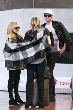 Chloë Grace Moretz, a friend, and a coat that binds them.
