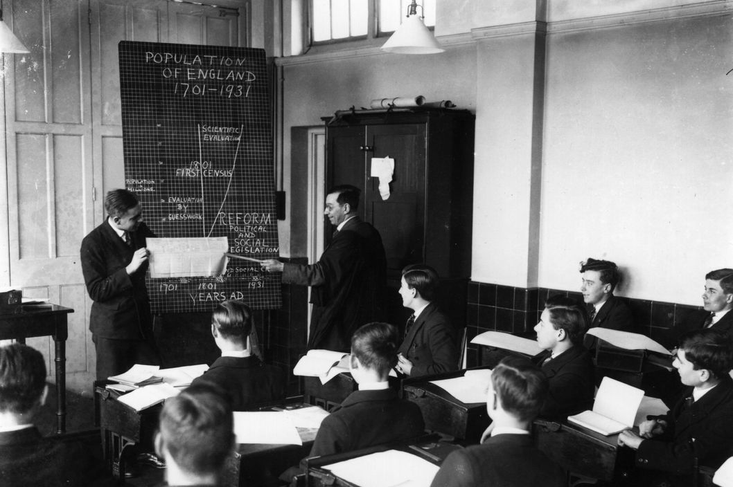 circa 1931:  Schoolboys at Tooting Bec School, south London, learn about the background to the census.