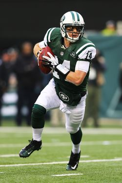 Greg McElroy #14 of the New York Jets scrambles to  throw his first touchdown in the NFL to  Jeff Cumberland #86 against the Arizona Cardinals during their game at at MetLife Stadium on December 2, 2012 in East Rutherford, New Jersey. The Jets won 7-6.